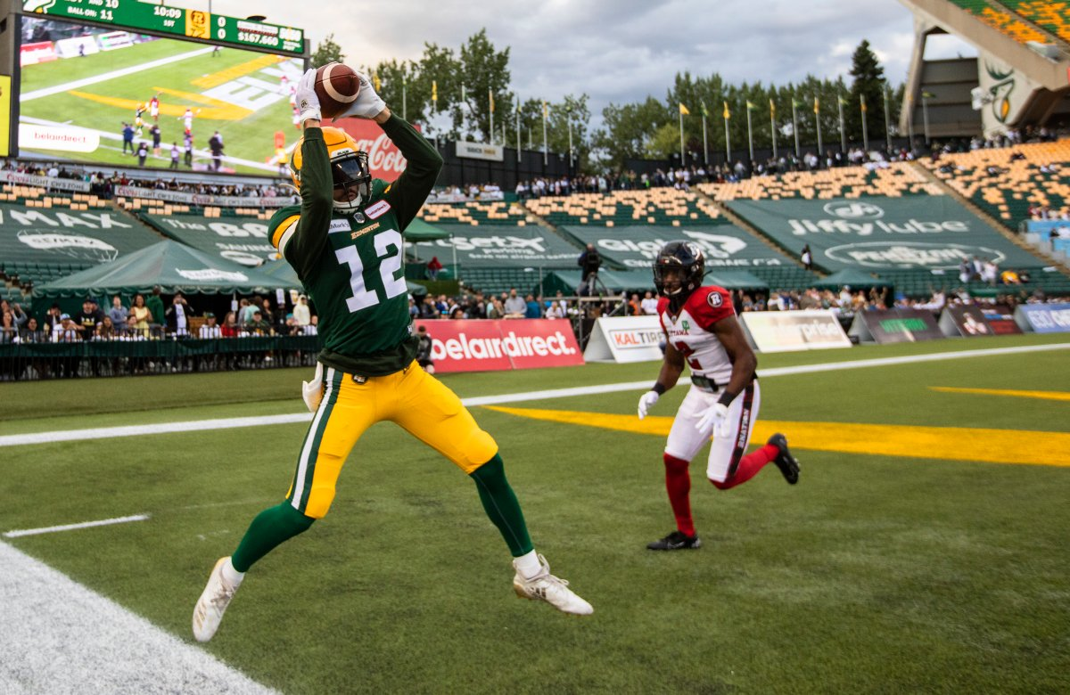 Ottawa Redblacks' Randall Evans (2) gives chase as Edmonton Elks' Mike Jones (12) makes the catch out of bounds during first half CFL action in Edmonton, Alta., on Saturday August 7, 2021.
