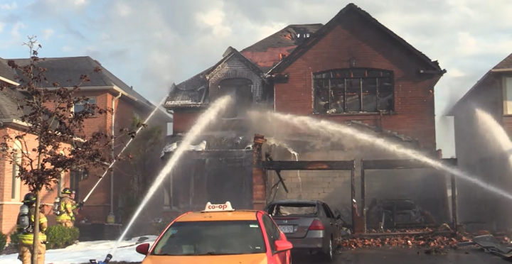 Fire crews battle a house fire in Pickering on Tuesday.