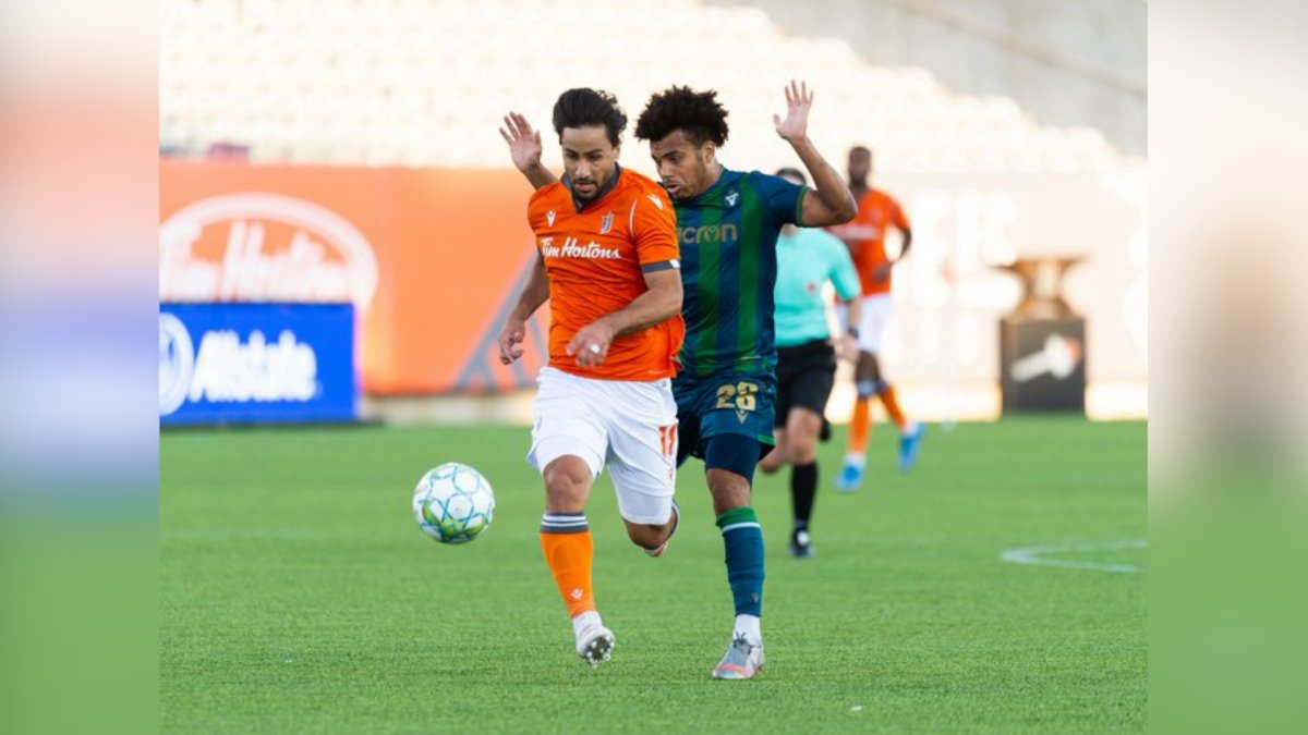 Forge FC's Mo Babouli and York United's Cedric Toussaint in action at Tim Horton's field during  a CPL match on Aug. 4, 2021.