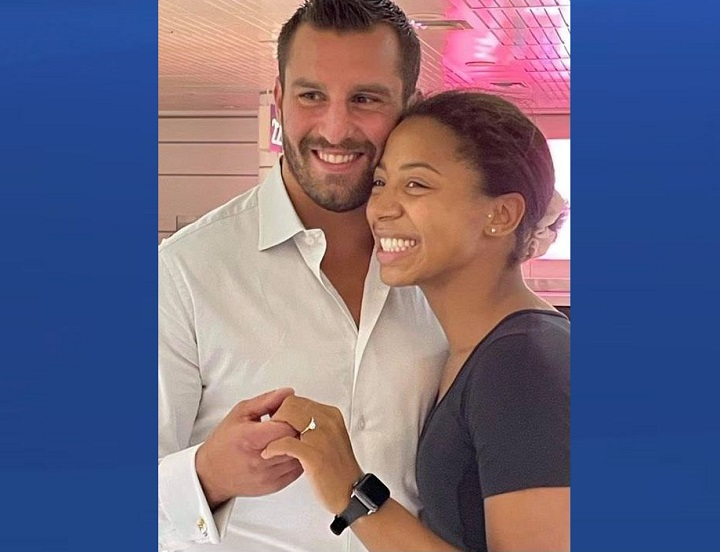 Jennifer Abel is seen with her fiancé David Lemieux after he proposed at Trudeau International Airport on Monday, Aug. 3, 2021.