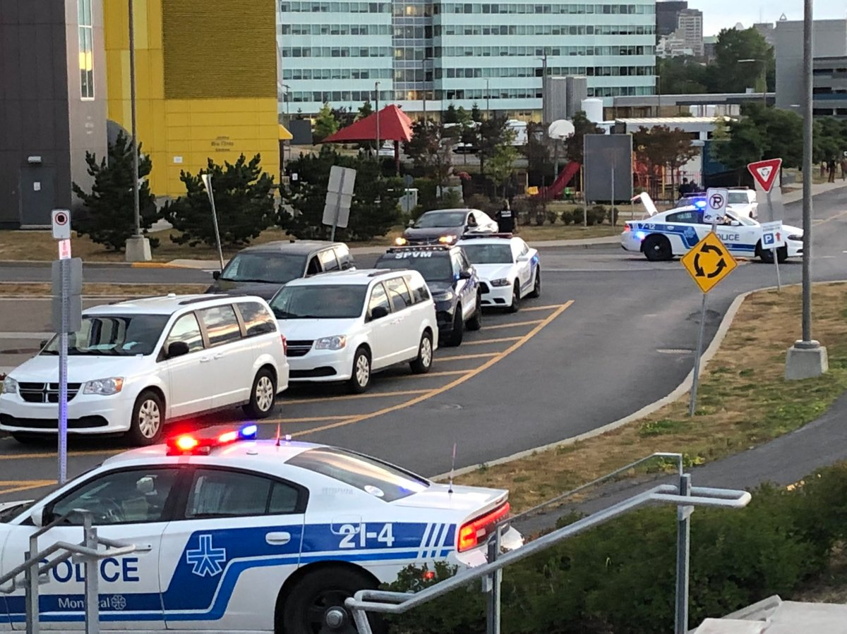 A heavy police presence is seen outside the McGill University Health Centre on Tuesday, Aug. 24, 2021.