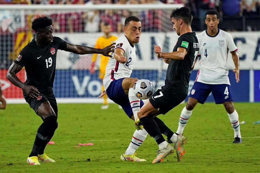 United States defender Sergino Dest (2) battles for the ball with Canada defender Alphonso Davies (19) and Canada midfielder Stephen Eustaquio (7) during the first half of a World Cup soccer qualifierin Nashville, Tenn., Sunday, Sept. 5, 2021.