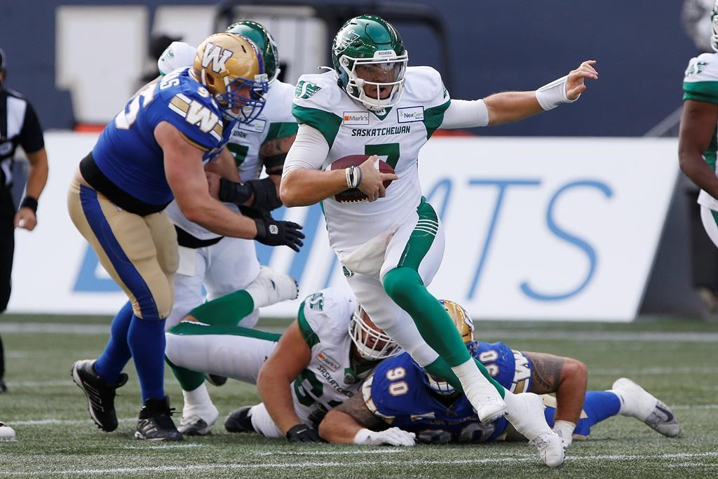 Saskatchewan Roughriders quarterback Cody Fajardo (7) scrambles for the first down during the first half of CFL action against the Winnipeg Blue Bombers in Winnipeg, Sept. 11, 2021.