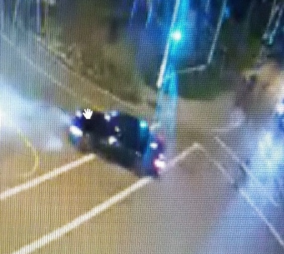 Surrey RCMP are looking for the driver of a black sedan after shots were fired at a frontline officer Friday night. Photo provided by Surrey RCMP.