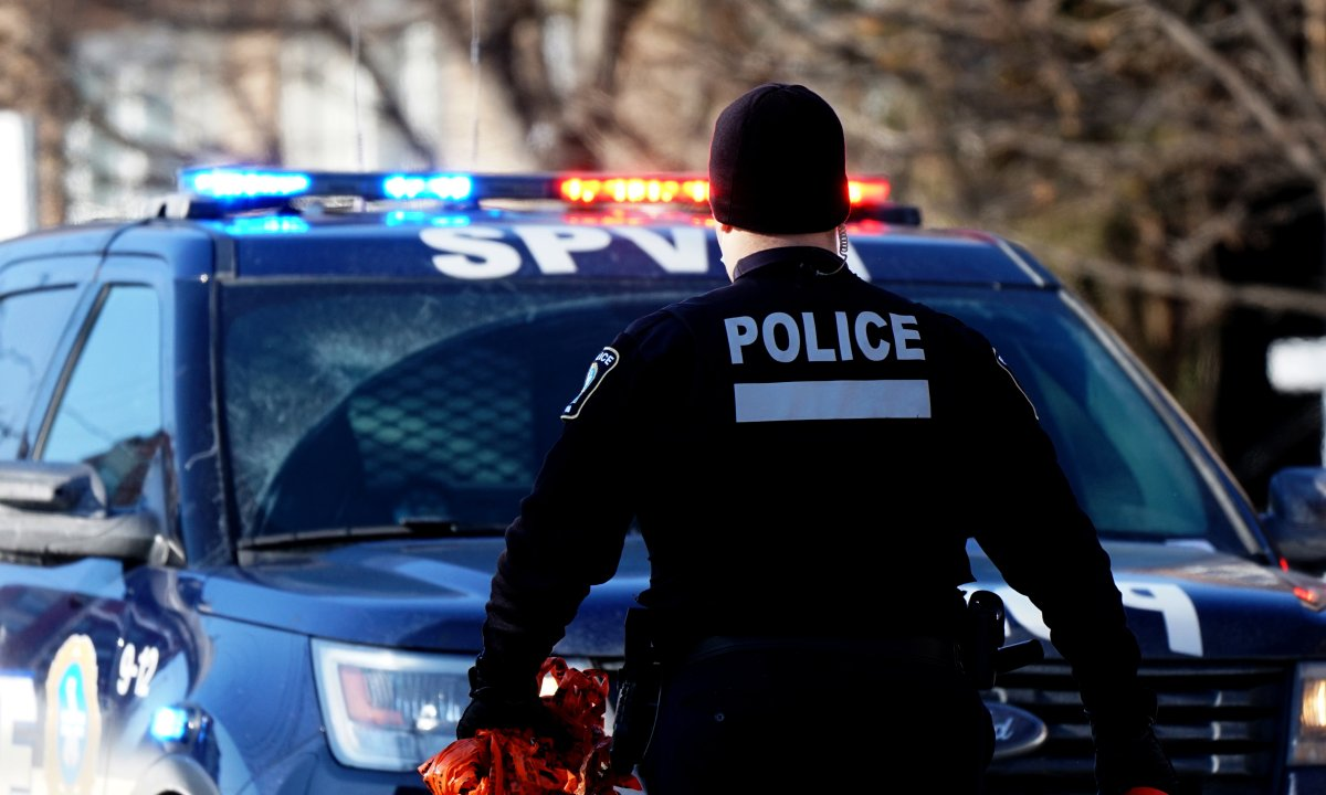 Montreal police officer at a crime scene in Montreal, Que., Sunday, February 14, 2021.