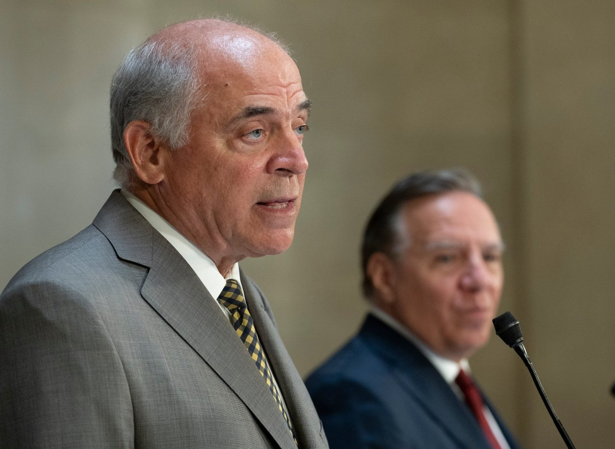 Quebec Economy and Innovation Minister Pierre Fitzgibbon responds to reporters questions as Quebec Premier Francois Legault, right, looks on during a news conference on Wednesday, September 1, 2021 at the legislature in Quebec City.