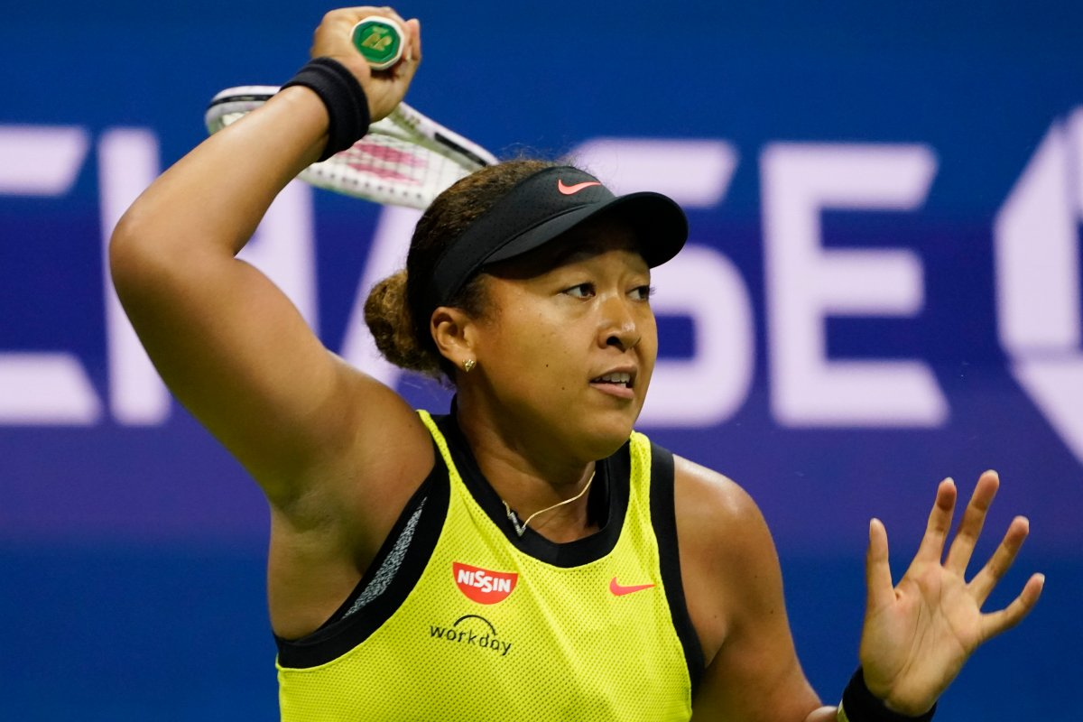 Naomi Osaka, of Japan, returns a shot to Leylah Fernandez, of Canada, during the third round of the US Open tennis championships, Friday, Sept. 3, 2021, in New York. (AP Photo/John Minchillo).