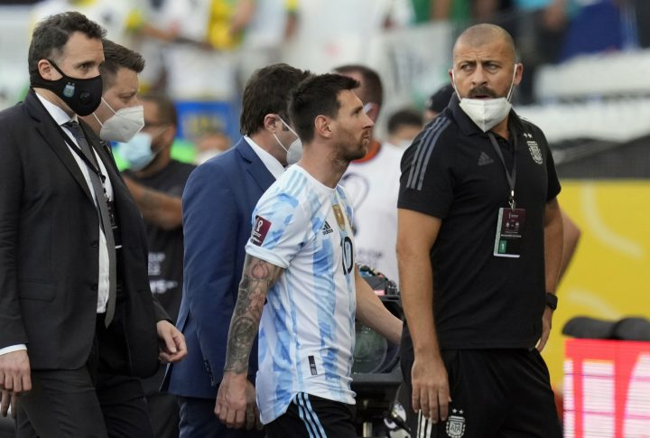 Argentina's Lionel Messi walks off the field after the qualifying soccer match for the FIFA World Cup Qatar 2022 against Brazil was interrupted by health officials in Sao Paulo, Brazil, Sunday, Sept. 5, 2021.
