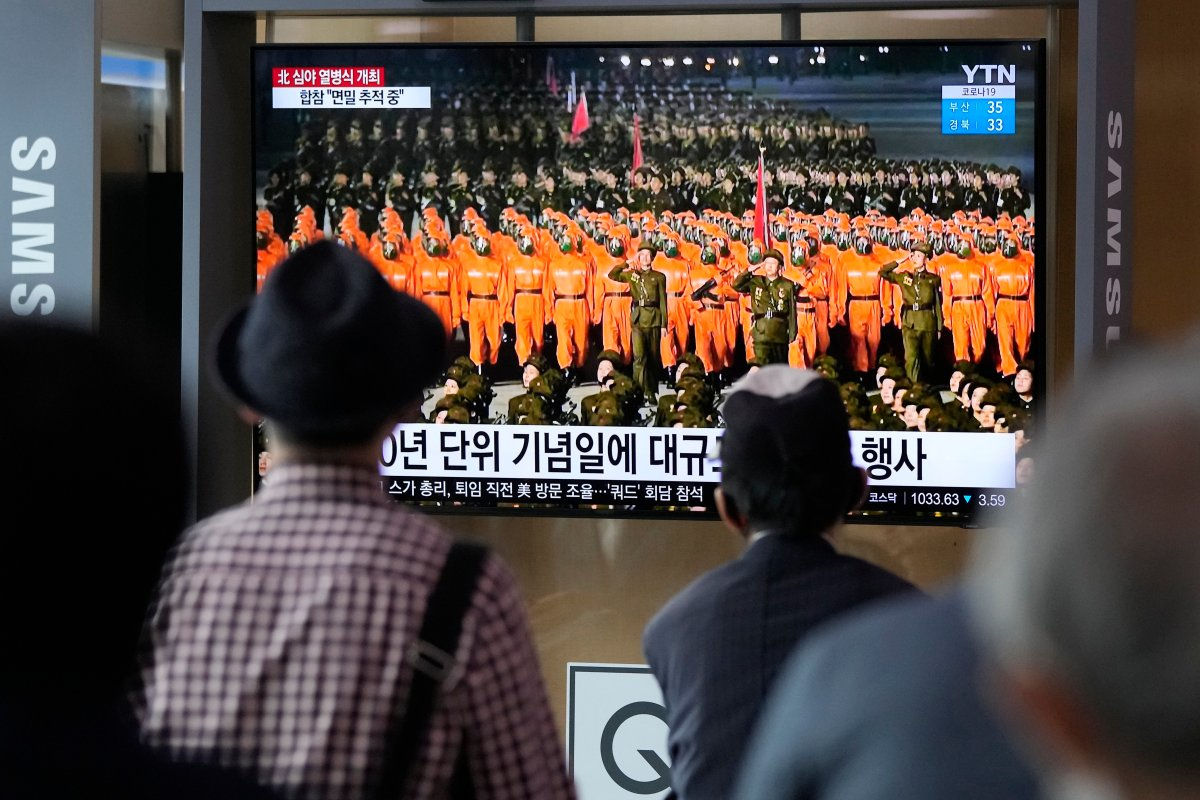 People watch a TV showing a military parade held in Pyongyang, North Korea, at Seoul Railway Station in Seoul, South Korea, Thursday, Sept. 9, 2021. North Korea paraded goose-stepping soldiers and military hardware in its capital overnight in a celebration of the nation's 73rd anniversary that was overseen by leader Kim Jong Un, state media reported Thursday. (AP Photo/Ahn Young-joon).