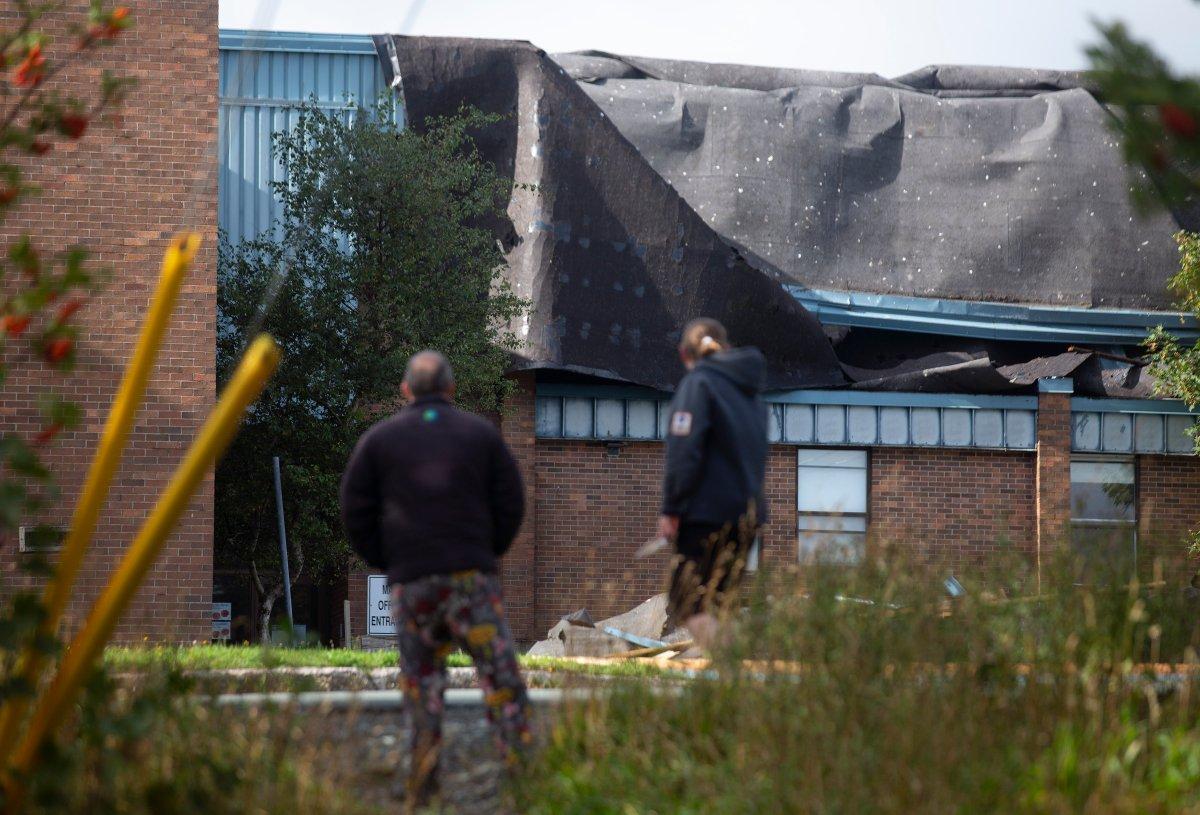 The roof of Mary Queen of Peace elementary school was torn off after Hurricane Larry crossed over Newfoundland's Avalon Peninsula in the early morning hours, in St. John's, Saturday, Sept. 11, 2021. THE CANADIAN PRESS/Paul Daly.
