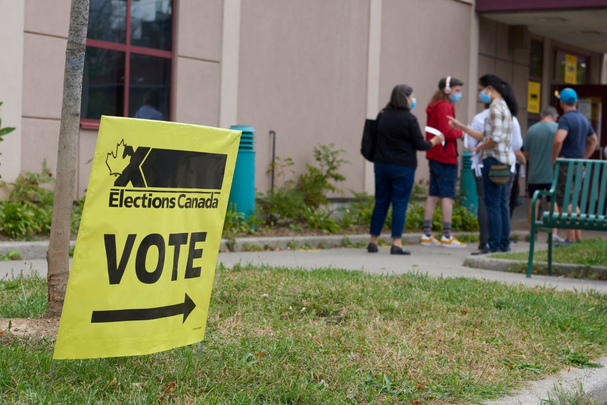 Voters line up outside an Elections Canada polling station.