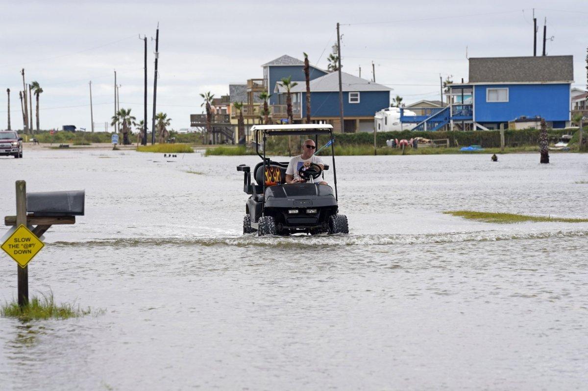 Joe Ward drives down through floodwaters from Hurricane Nicholas Tuesday, Sept. 14, 2021, in Surfside Beach, Texas. (AP Photo/David J. Phillip).