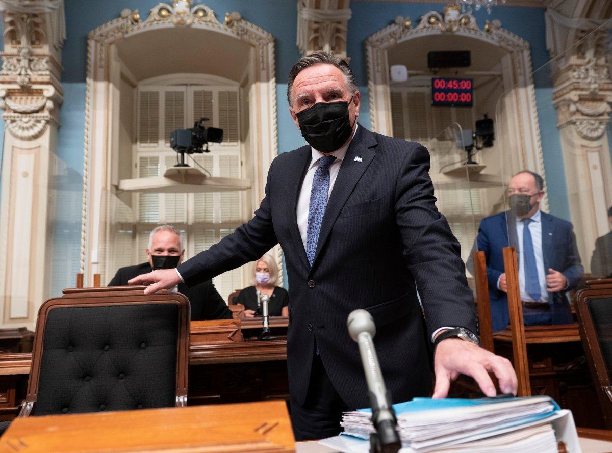 Quebec Premier Francois Legault walks in for question period Thursday, September 23, 2021 at the legislature in Quebec City.