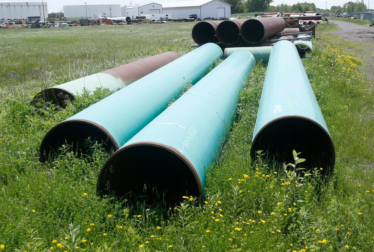 FILE - In this June 29, 2018, file photo, pipeline used to carry crude oil is shown at the Superior terminal of Enbridge Energy in Superior, Wis.