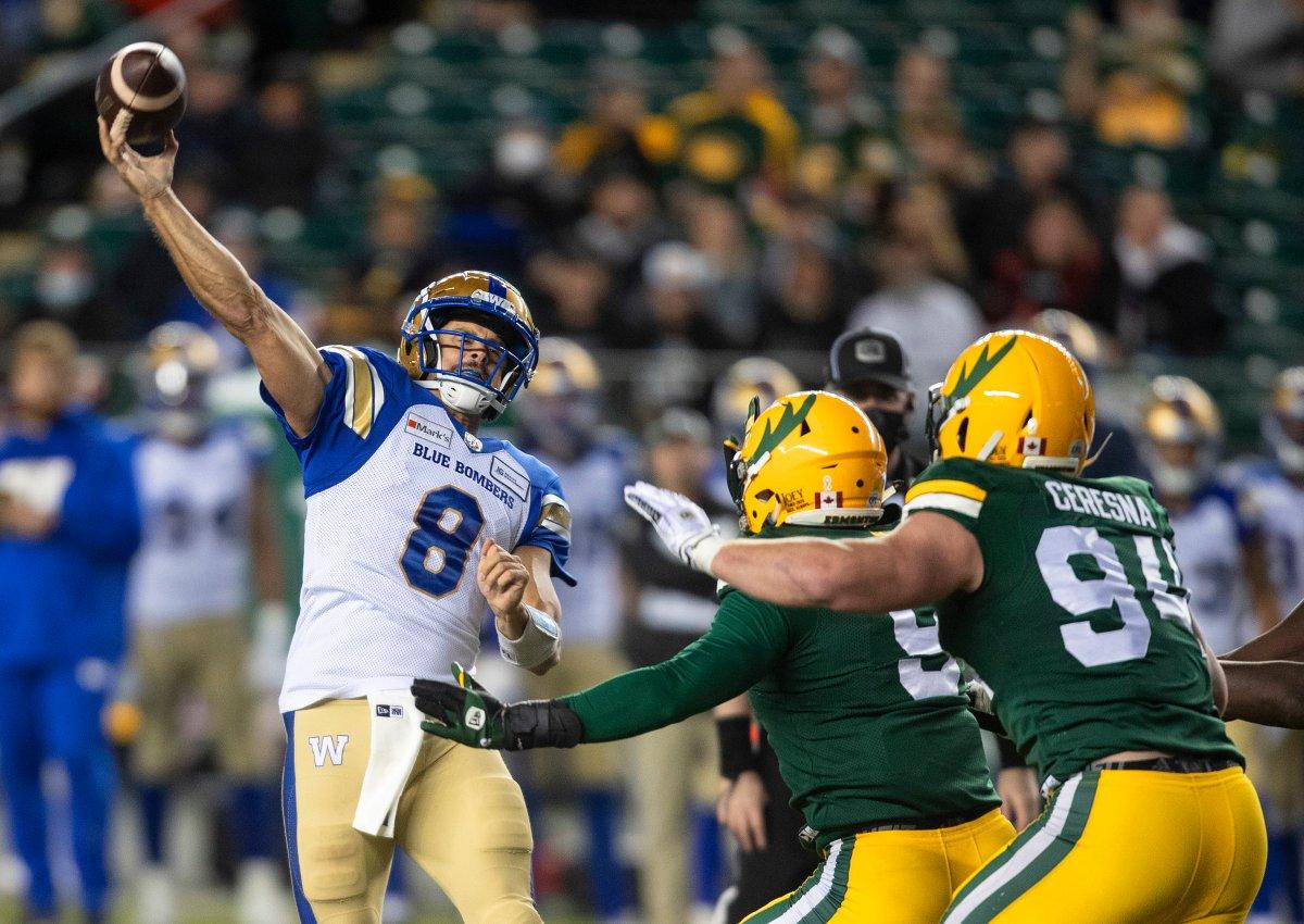 Winnipeg Blue Bombers quarterback  Zach Collaros (8) makes the throw against the Edmonton Elks during first half CFL action in Edmonton, Alta., on Saturday, September 18, 2021.