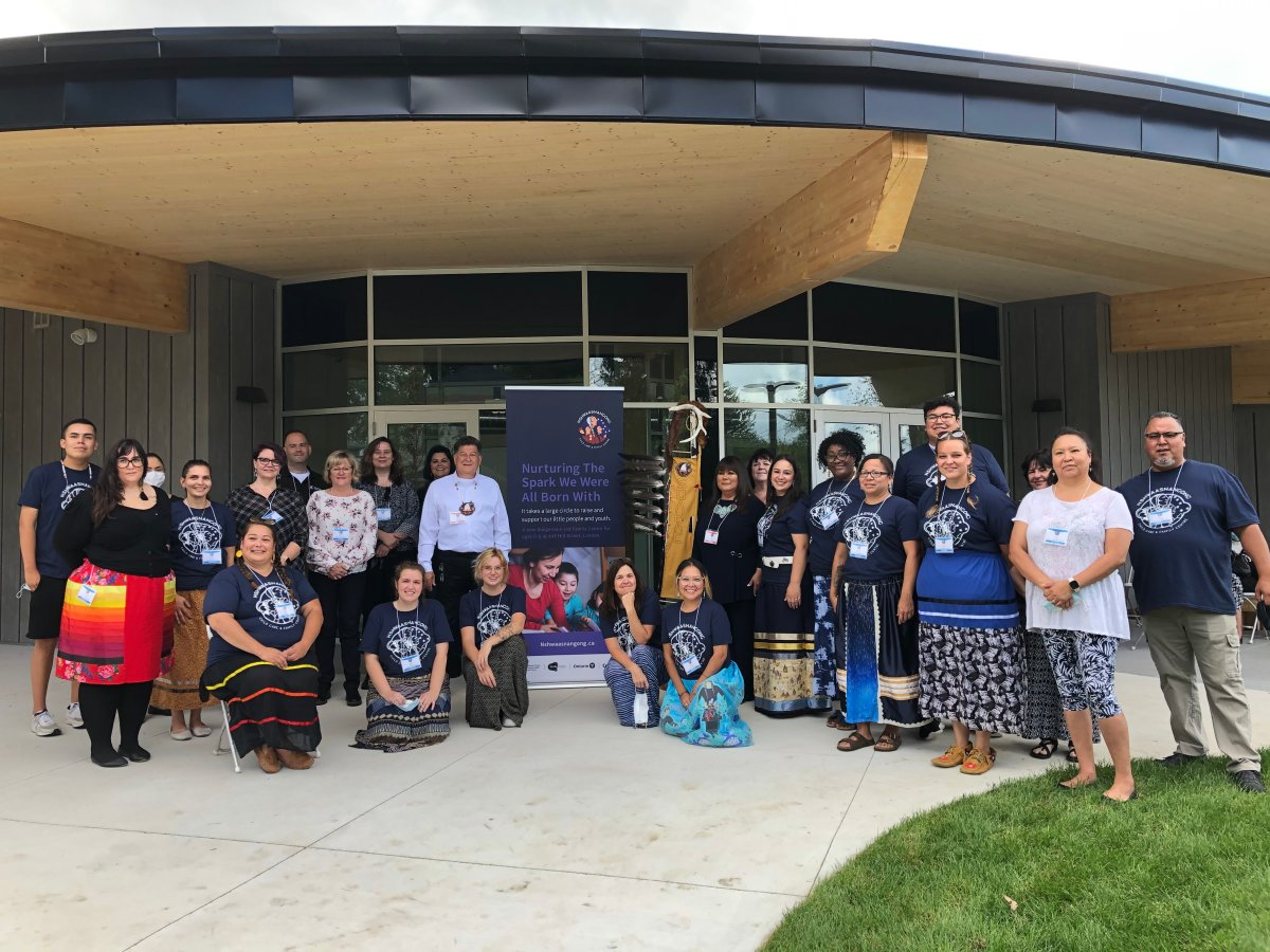 Staff gather for the soft opening of the Nshwaasnangong Child Care and Family Centre on Sept. 16, 2021.