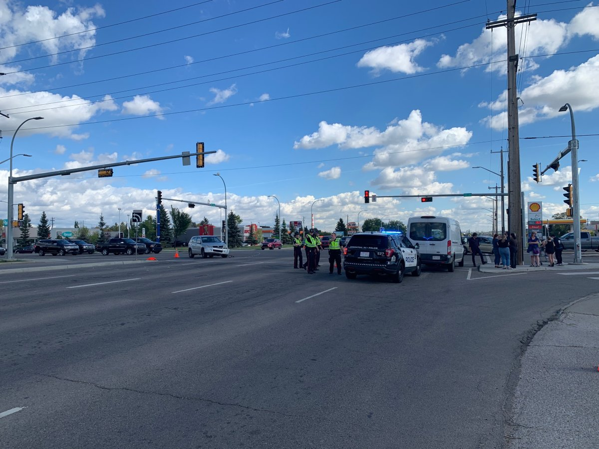Edmonton police investigate a hit-and-run collision involving a vehicle and two elderly pedestrians near 50 Street and 101 Avenue, Sept. 10, 2021.