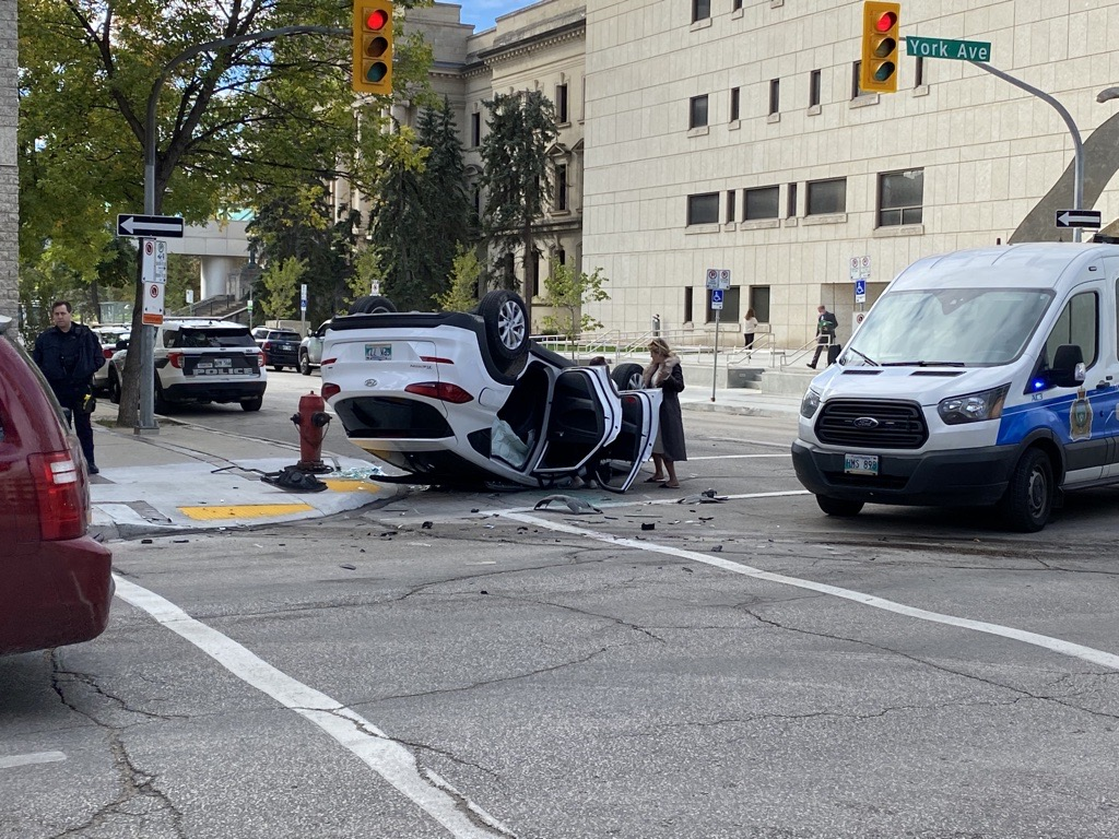 Emergency crews at the scene of a two-vehicle crash in downtown Winnipeg Friday.
