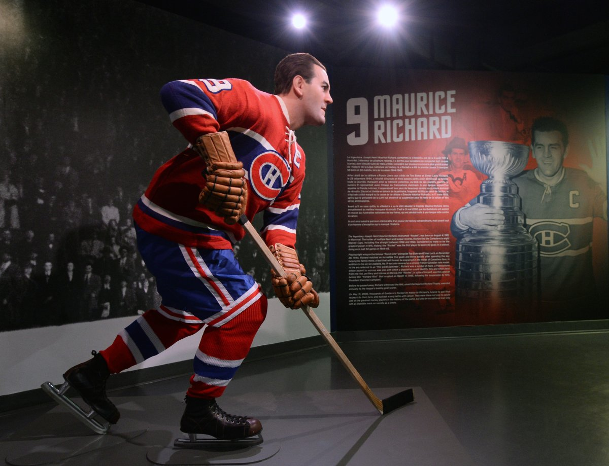 MONTREAL, QC - APRIL 10: A wax figure of Maurice ''Rocket'' Richard is inaugurated at the Montreal Canadiens Hall of Fame by Musee Grevin prior to the game between the New York Islanders  and the  Montreal Canadiens on April 10, 2014 at the Bell Centre in Montreal, Quebec, Canada. The wax statue was produced by Musee Grevin to celebrate Richard's life and accomplishments.