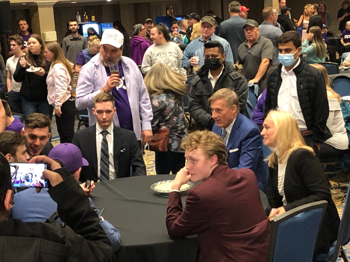 One photo from the PPC event shows PPC Leader Maxime Bernier sitting maskless at a table surrounded by supporters, most of who are not wearing masks.