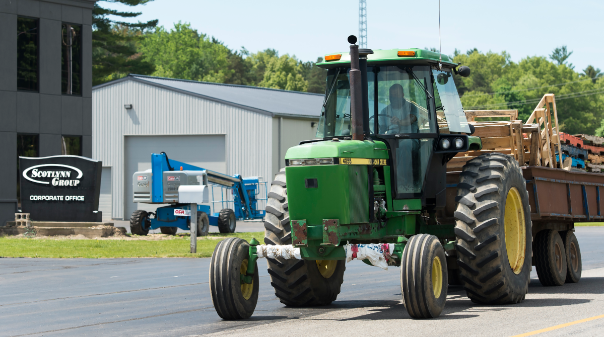 A tractor drives past the main office at the Scotlynn Group where 164 Migrant workers have tested positive for COVID-19 shutting down the asparagus farming facility temporarily during the COVID-19 pandemic near Vittoria, Ont., in Norfolk County on Wednesday, June 3, 2020. THE CANADIAN PRESS/Nathan Denette .