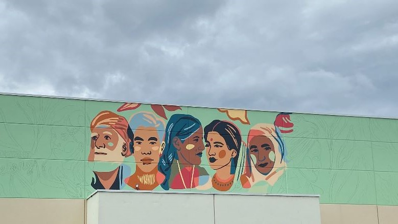 The mural, as seen while being created on Tuesday, Aug. 31, 2020. The mural stems from what police called a hate-motivated vandalism incident involving a local home in July 2020.