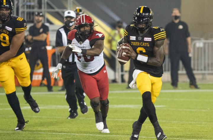Hamilton Tiger-Cats quarterback David Watford (6) scrambles during first half CFL football game action against the Calgary Stampeders in Hamilton, Ont. on Friday, September 17, 2021.