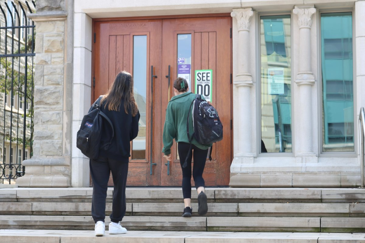Two students walking into Sydenham Hall at Western University on Sept. 13, 2021.