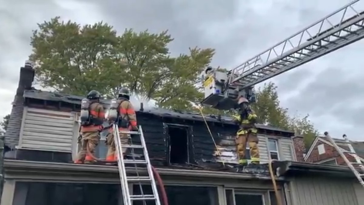 Firefighters dousing hot spots at a home on Regent Street on Sept. 15, 2021.