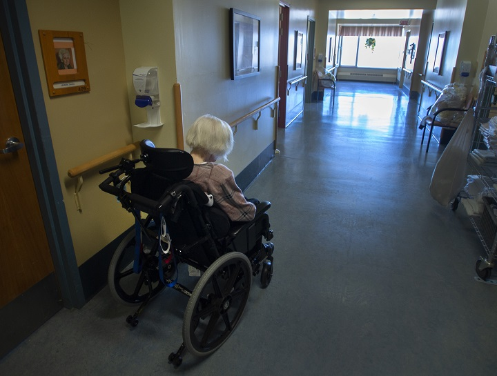 A resident makes her way down a hallway at CHSLD Rose-de-Lima seniors residence Friday, March 12, 2021 in Laval, Quebec.