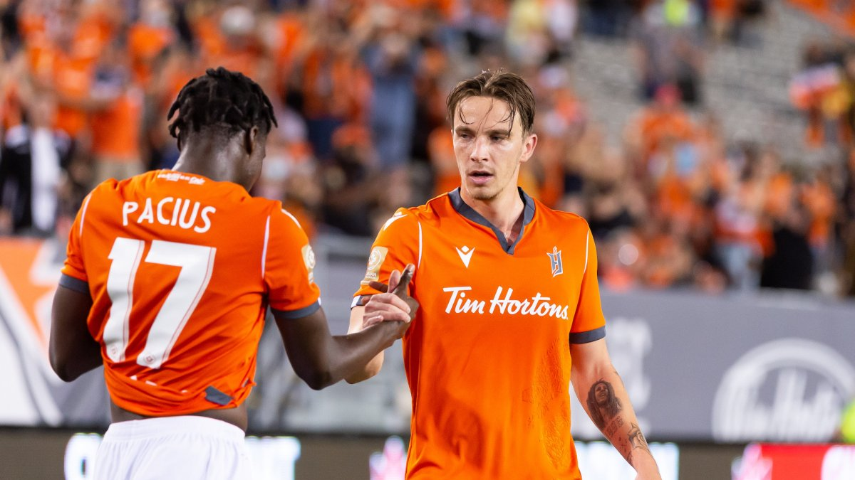 Forge FC forward Woobens Pacius and defender Daniel Krutzen during Canadian Championship match at Tim Horton's field on Sept. 15, 2021.