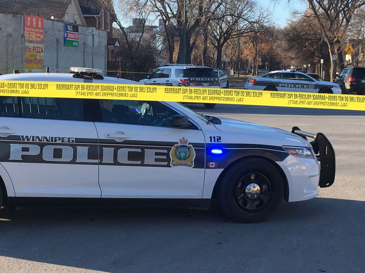 Winnipeg police at the scene of the 2020 homicide.