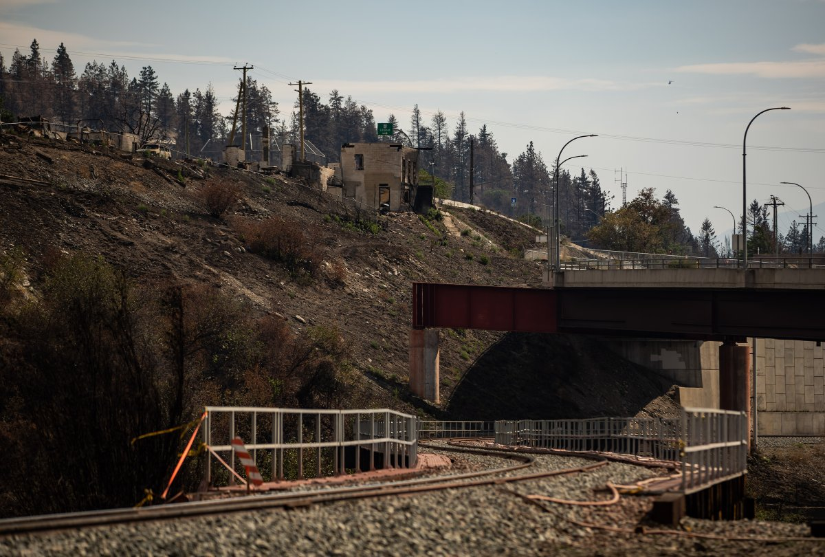 A property destroyed when the Lytton Creek wildfire swept through the community on June 30 is seen above railway tracks in Lytton, B.C., on Sunday, August 15, 2021.
