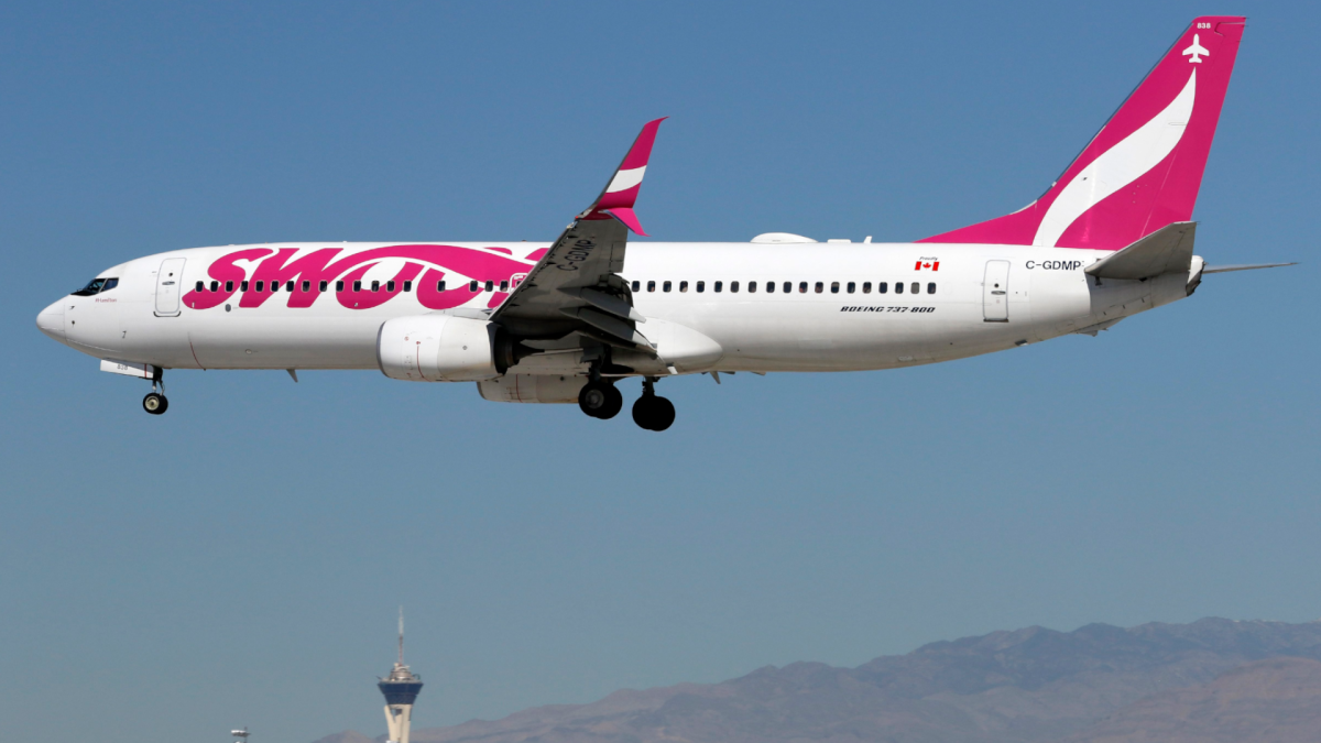 A Boeing 737 (737-800) jetliner, belonging to WestJet Airlines low-cost carrier Swoop, lands at McCarran International Airport in Las Vegas, Nv., on Thur., Feb. 27, 2020. THE CANADIAN PRESS IMAGES/Larry MacDougal .