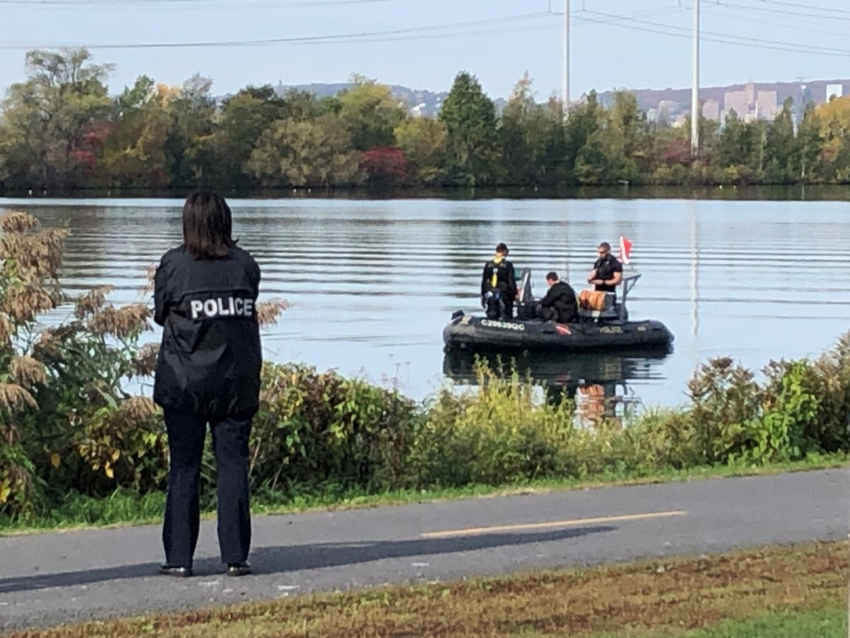 Police search the waterfront in Brossard for a missing man on Tuesday, Oct. 12, 2021.