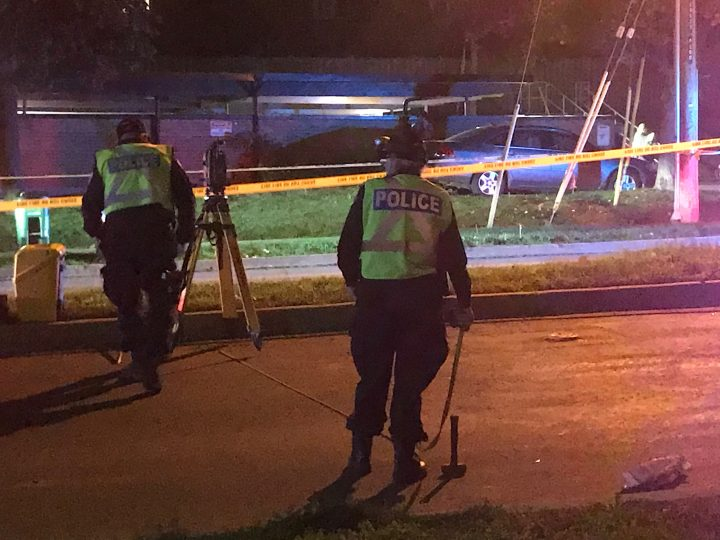 Investigators at the scene of a fatal collision in the area of Don Mills Road and The Donway on Wednesday.
