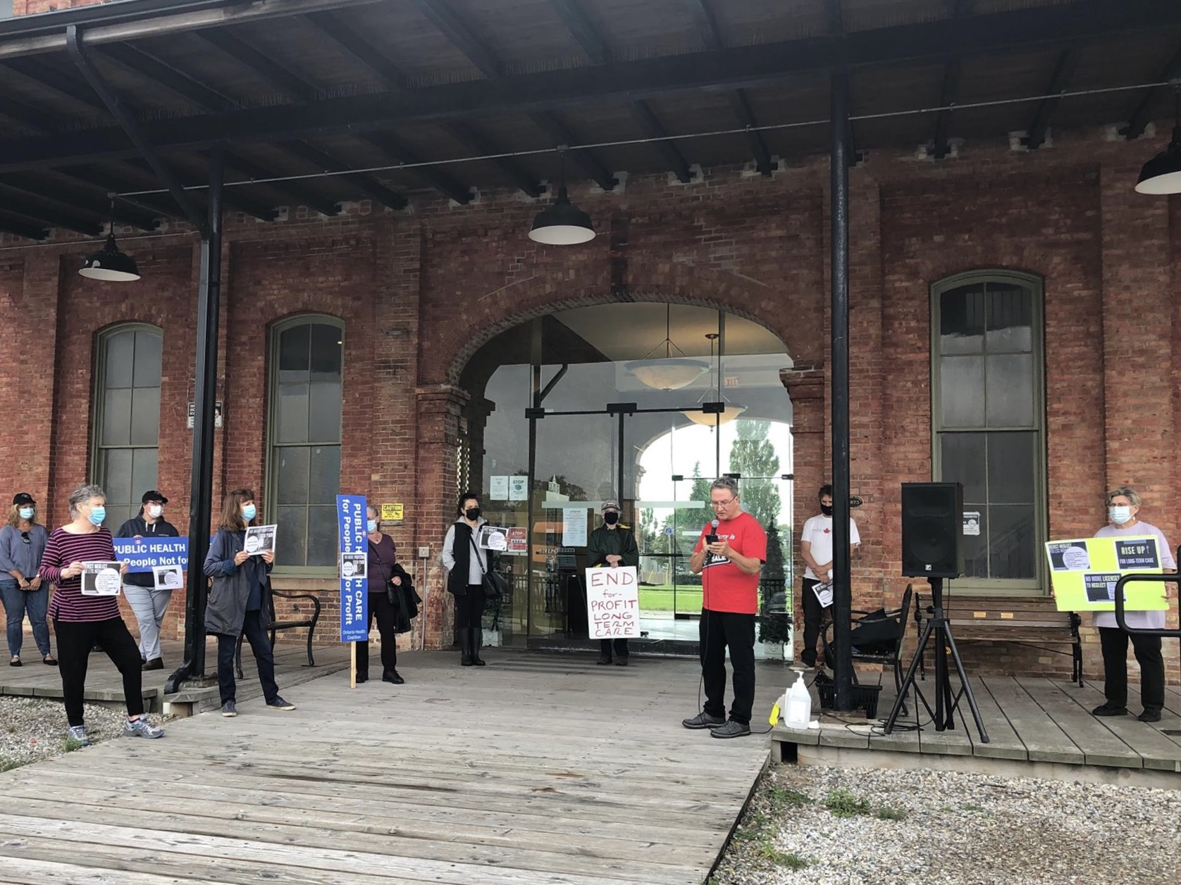 Around 17 people gathered outside MPP, Jeff Yurek's office in St. Thomas to advocate for changes to long-term care on Oct. 4, 2021.